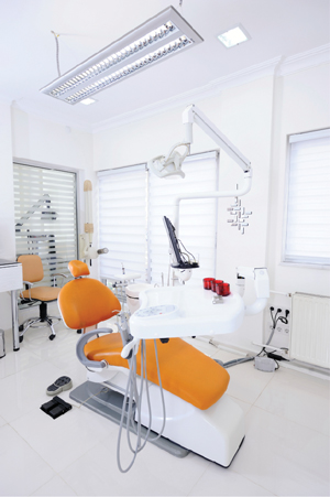 Orange dental chair in dental office