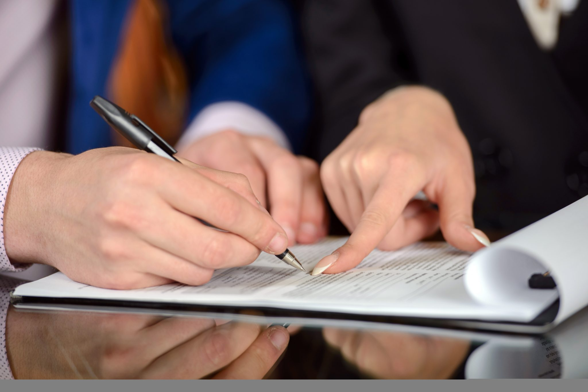 Veterinarian and lease consultant reading a lease